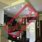 فروش آپارتمان 2 خواب شیک و تمیز در قشم - به همراه با پارکینگ و انباری اختصاصی - آشپزخانه شیک با کابینت های MDF خرید آپارتمان در قشم - سند آزاد ( وام )